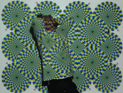 目の錯覚で円がまわる画像を破いたらもっと錯覚